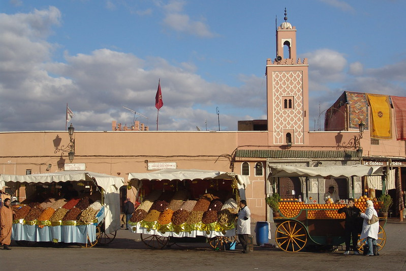 A local man enjoys a glass of orange juice on the Djemaa el-Fna in Marrakesh, Morocco.