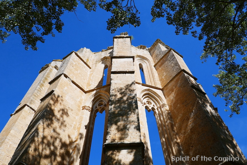 The Gothic ruins of the Monastery of San Antón rise into the Meseta sky.