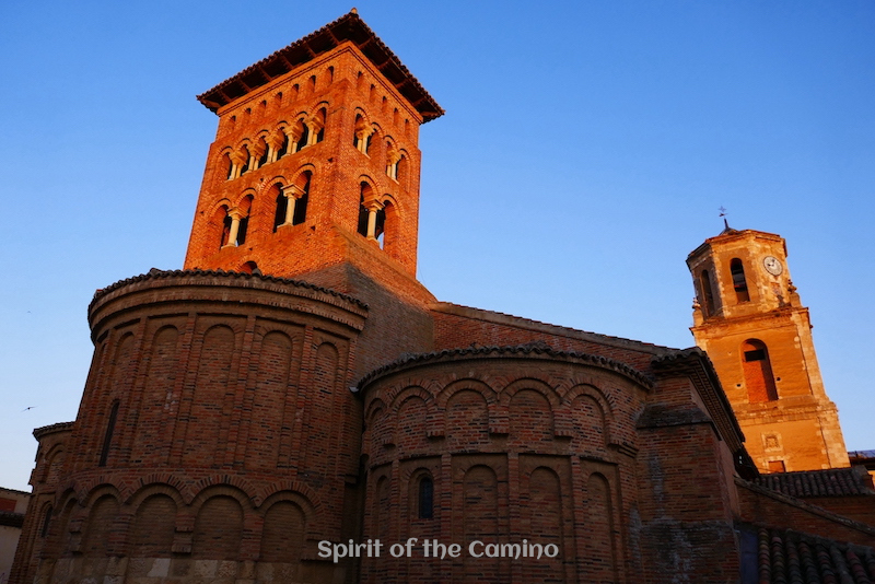 First light hits the church tower of San Tirso in Sahagún.