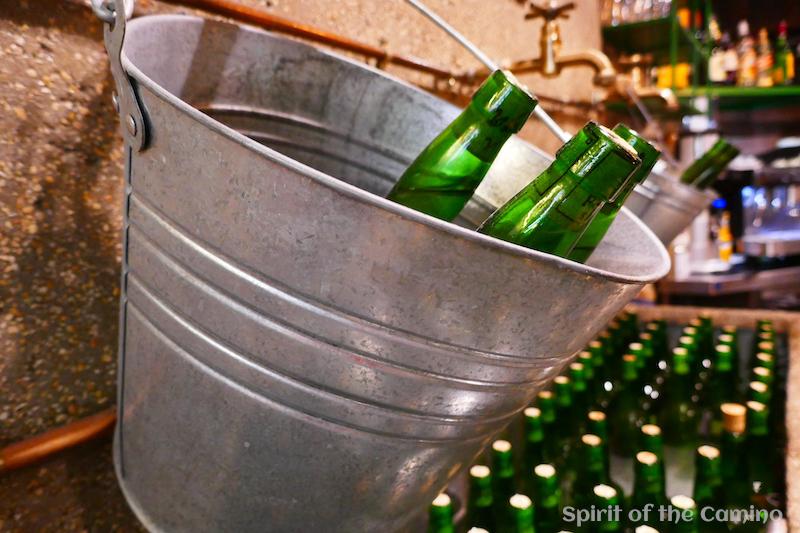 Bottles of cider in one of Oviedo's sidrerías.