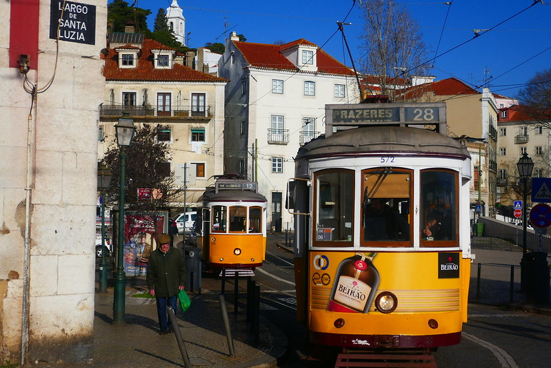The famous No.28 tram makes its way through Alfama.
