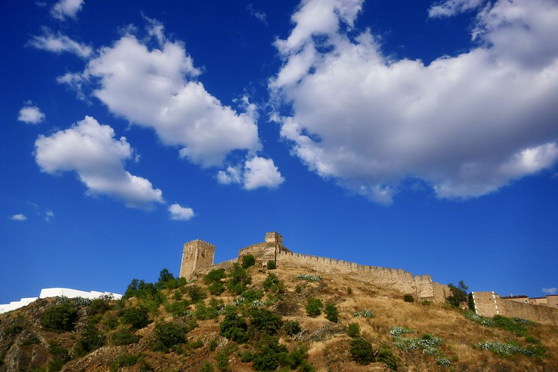 The 12th-century castle of Mértola and the surrounding landscape.
